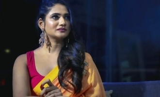 Losliya looks hot and stunning in saree in throwback pictures